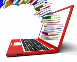 laptop and flying stack of books